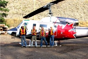 Crew with Bell 214 Helicopter